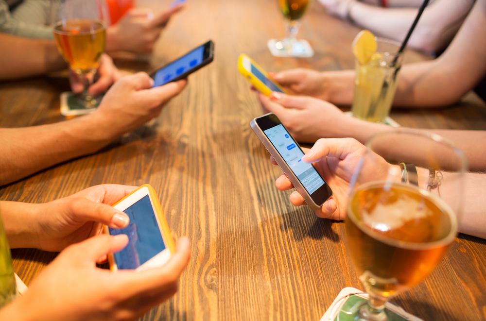 messaging apps at restaurant